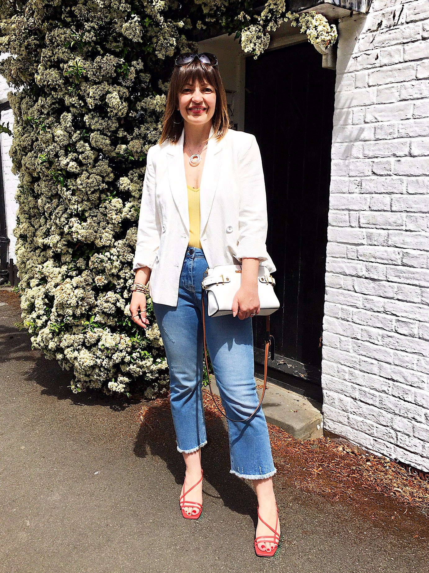 Kaleidoscope white blazer and blue mom jeans