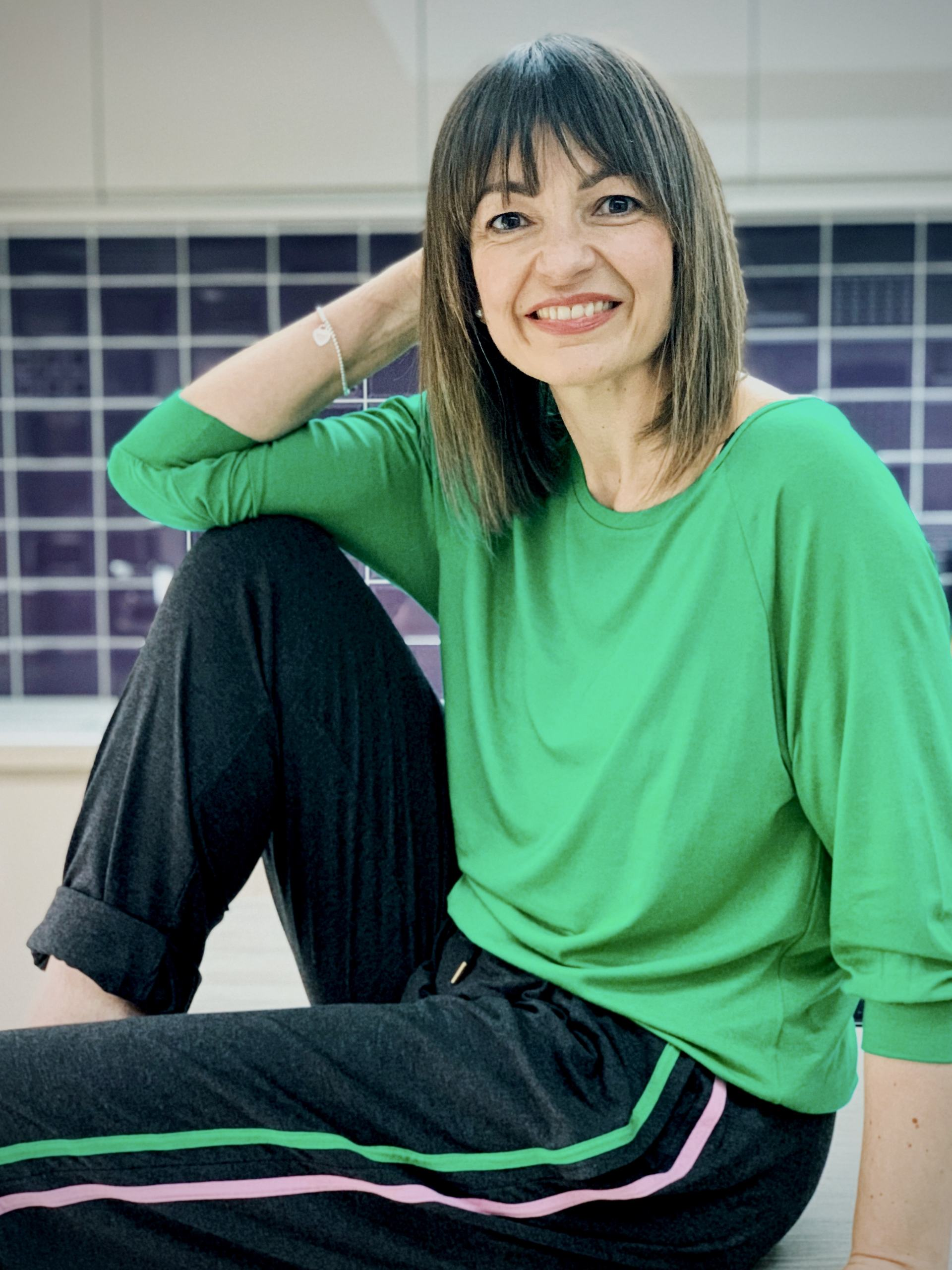 Lizzi Richardson wearing Asquith SS20 Collection wearing Embrace Tee in Green and Drawstring Pants