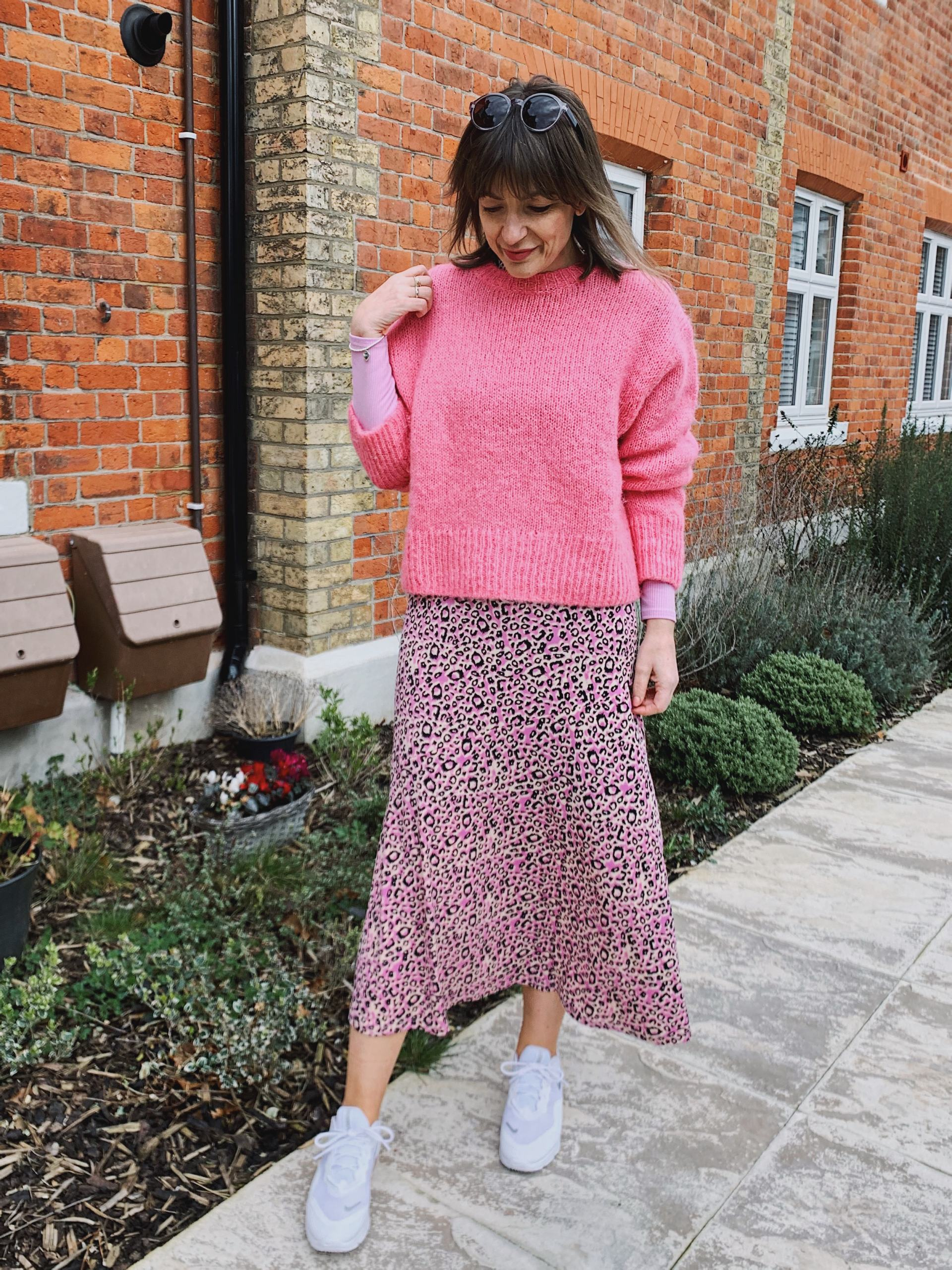 Pink jumper with lilac dress as a skirt