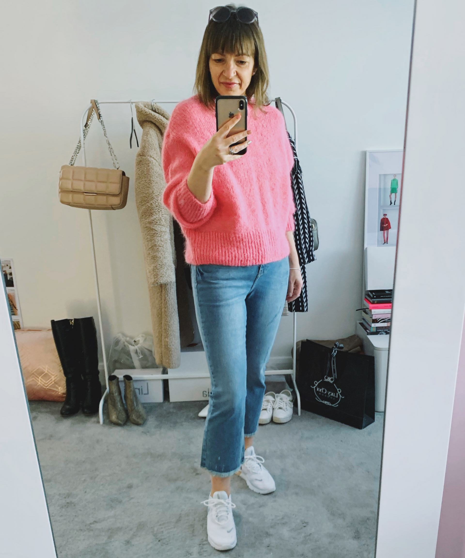 pink jumper with blue denim jeans in a mirror selfie