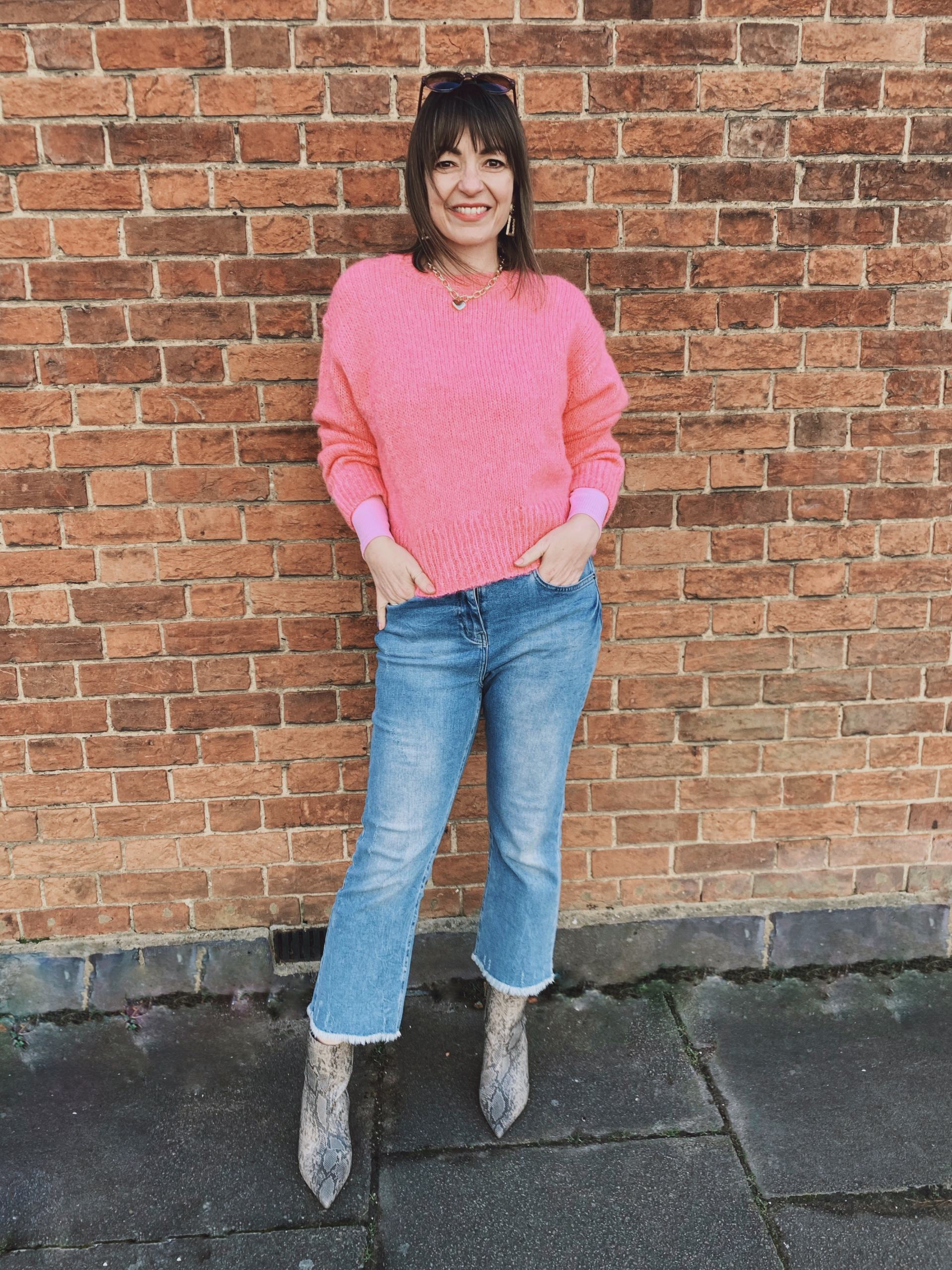 Pink jumper with jeans and skaeskin boots