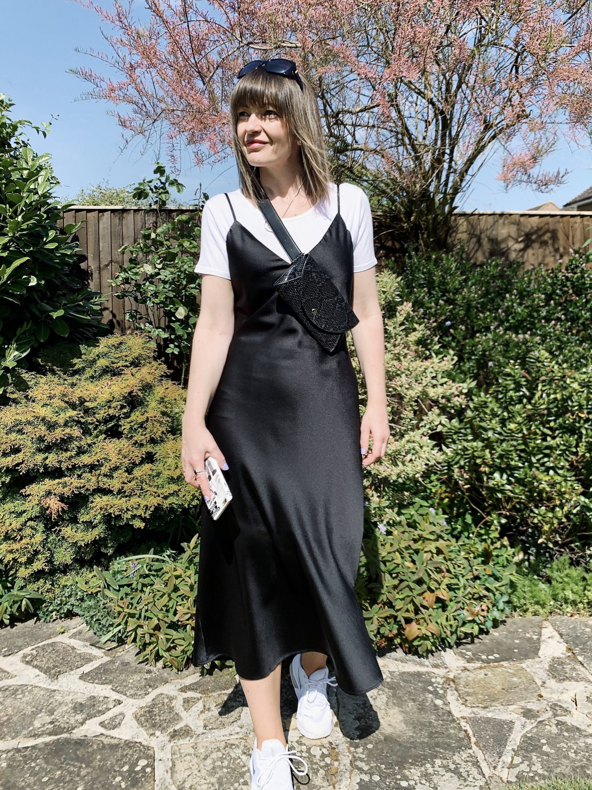 Black slip dress worn with trainers