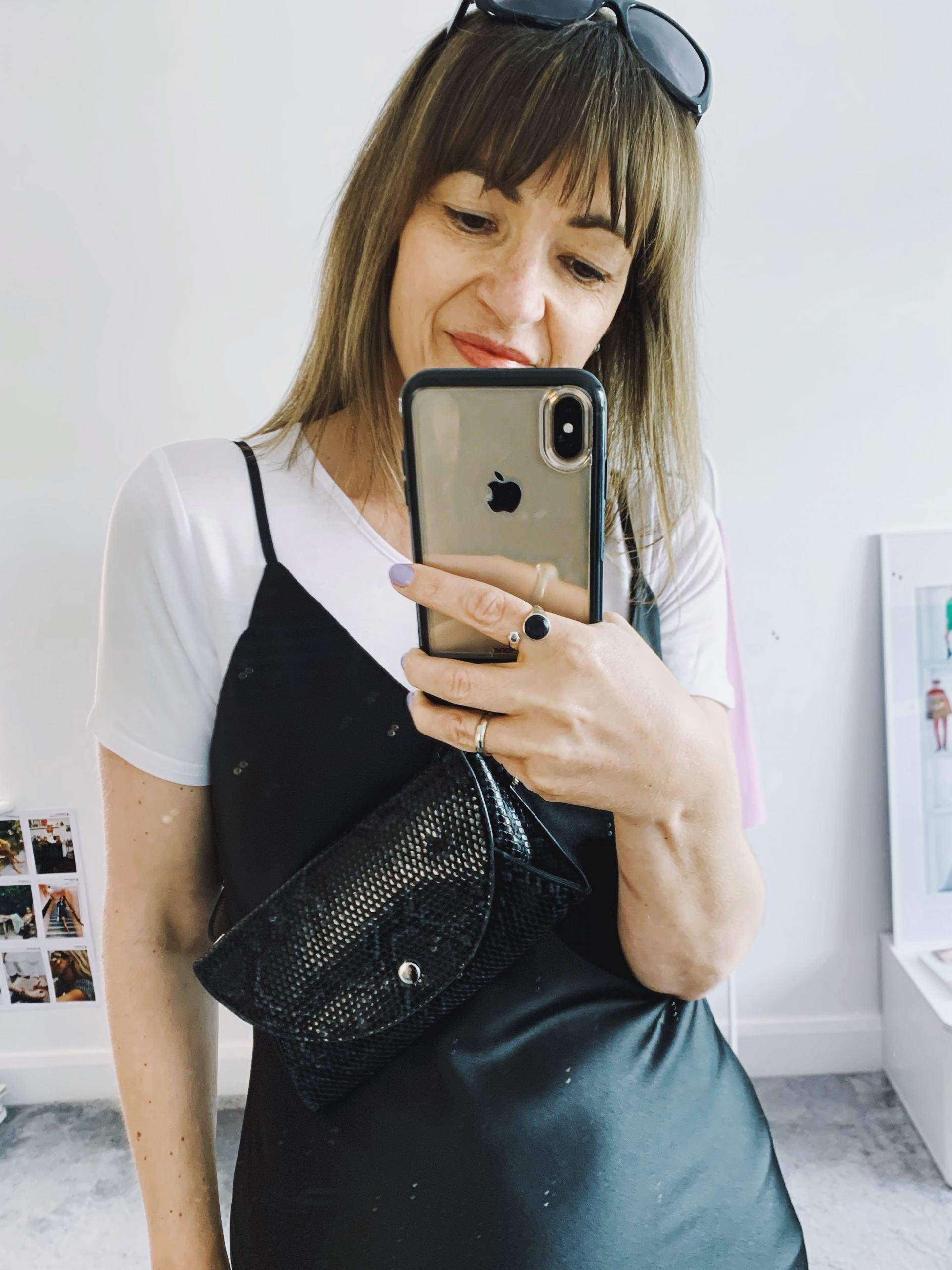 Black satin dress with small black bag