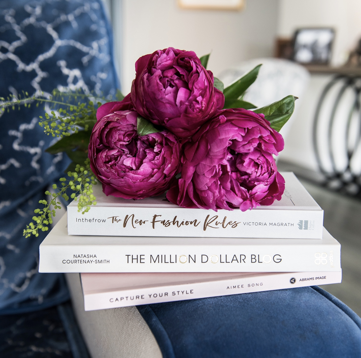 Three style books with three peonies