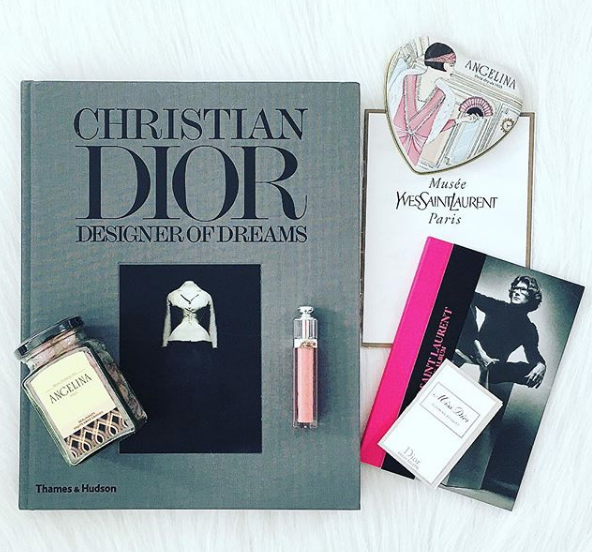 Christian Dior Designer of Dreams in a flatlay with other items