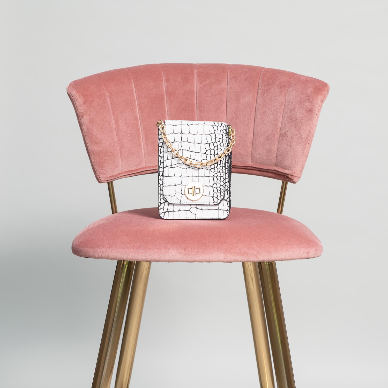 monochrome bag on a pink barstool