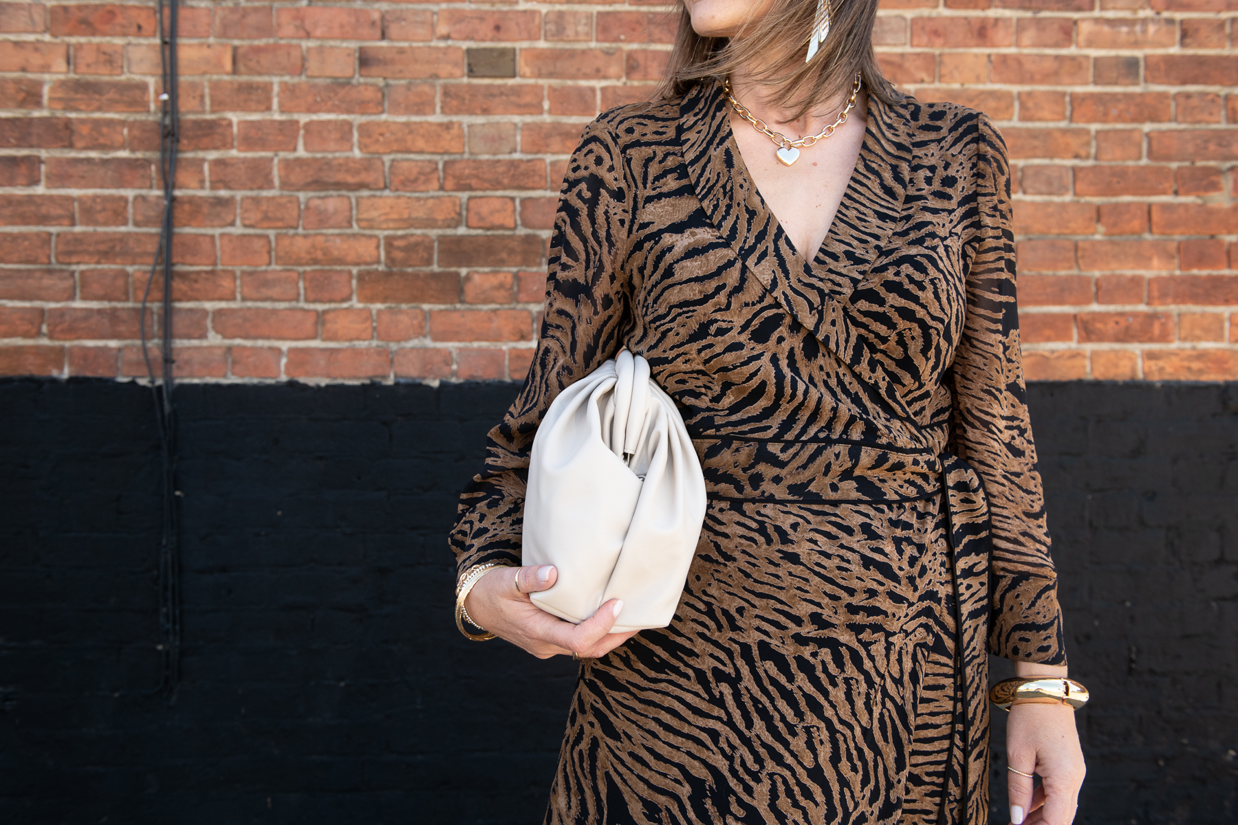 tiger fashion print with cream handbag