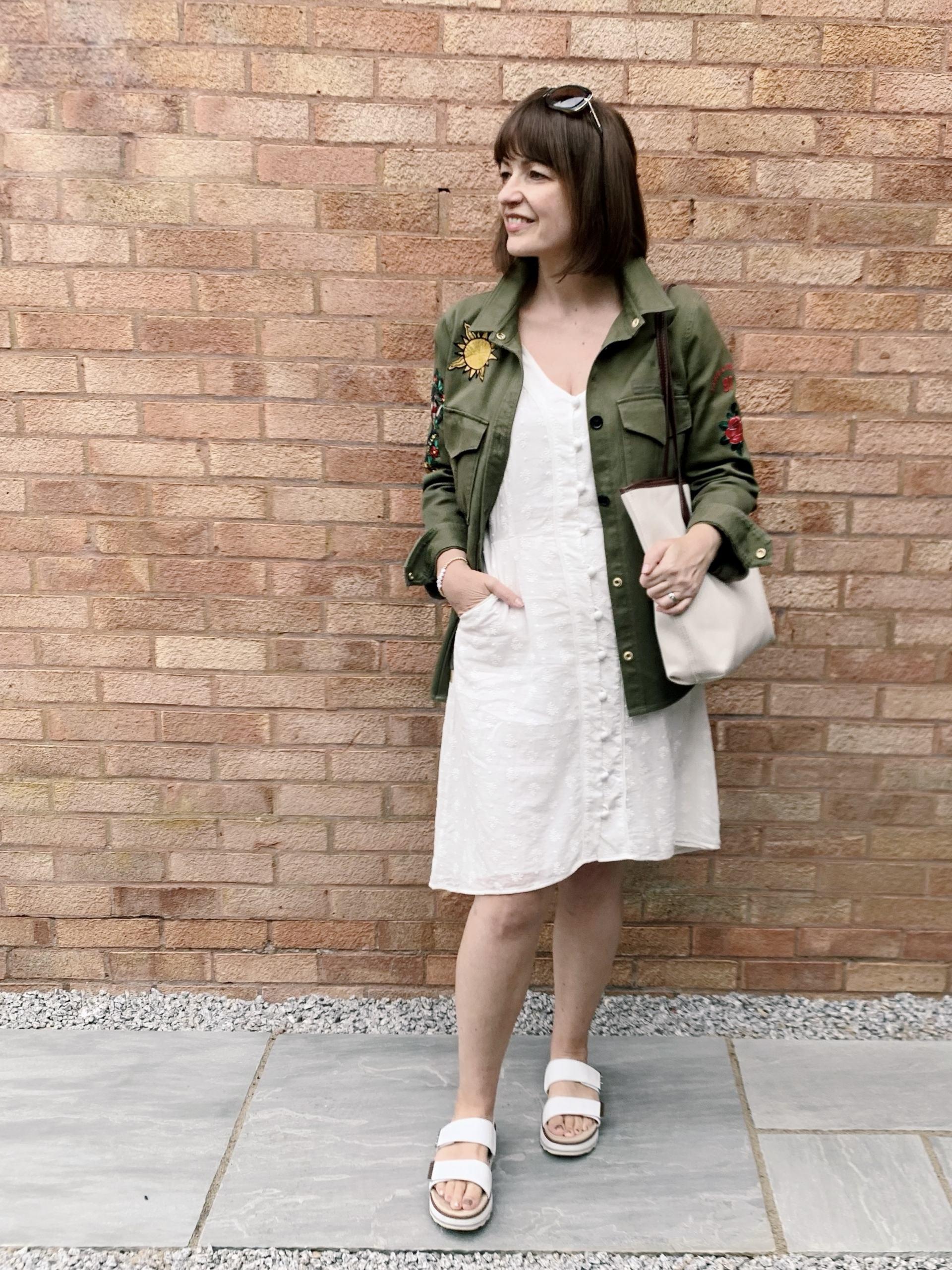Summer white dress with autumn trend of khaki