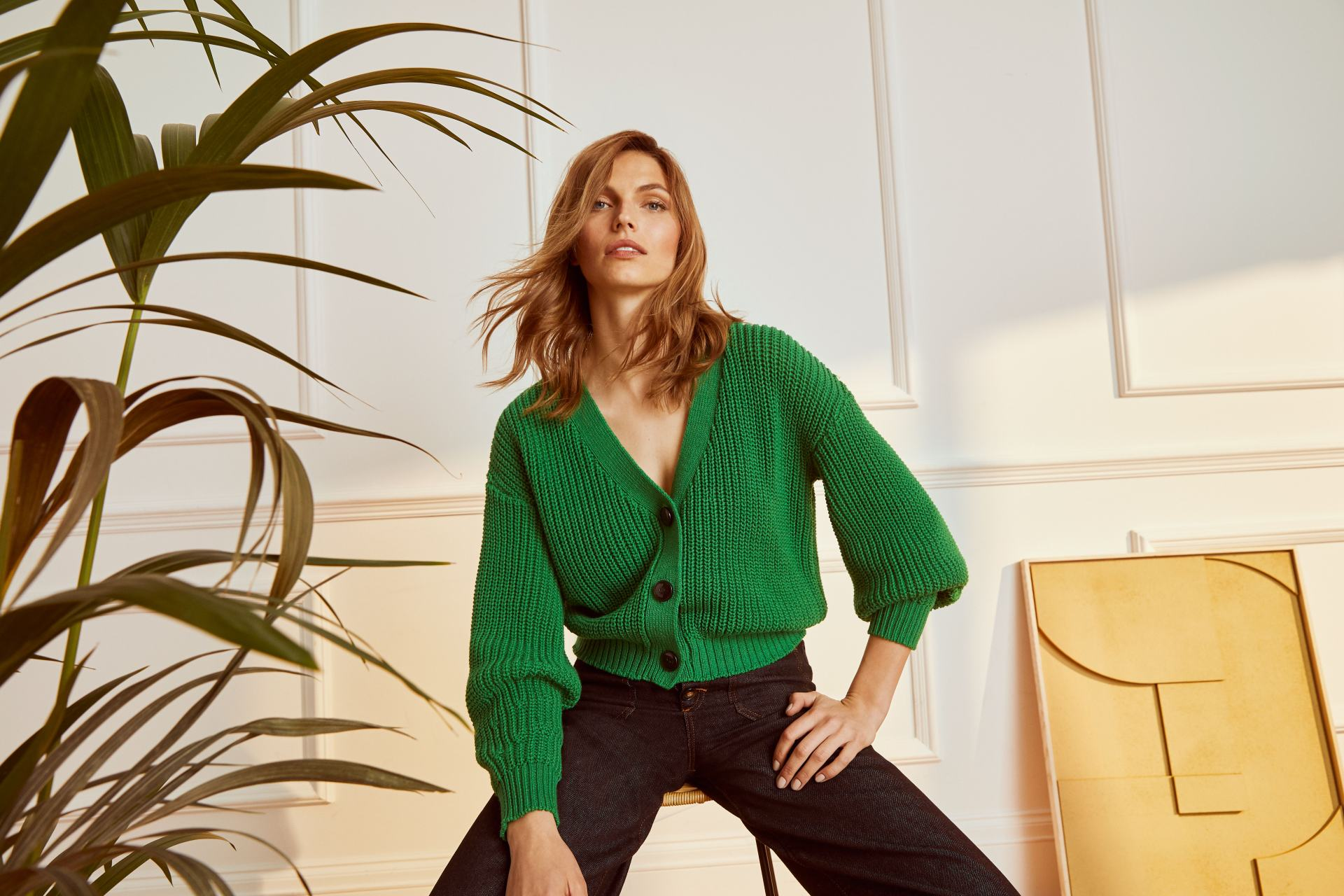 Model wearing Phase Eight AW21 green cardigan